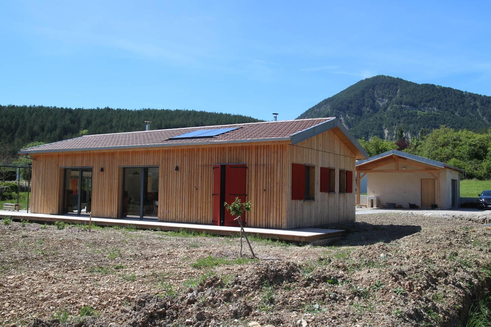 Maison bois die dans la dr me os bois for Chiffrage construction maison